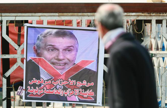 Le premier ministre désigné de l'Irak, Mohammed Taoufiq Allaoui, est rejeté par les manifestants, à Bagdad, le 29 février.