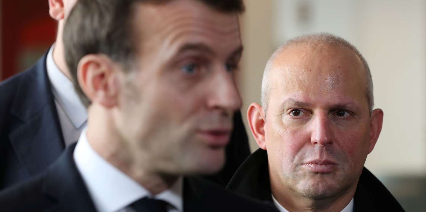 France's President Emmanuel Macron, speaks next to French Director General of Health Jerome Salomon during a visit to an EHPAD (Housing Establishment for Dependant Elderly People), in the 13th arrondissement of Paris, France amid fear of coronavirus disease (COVID-19) March 6, 2020. Ludovic Marin/Pool via REUTERS