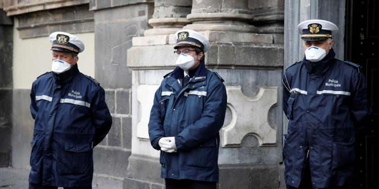 Policemen are seen on Duomo square after a decree orders for the whole of Italy to be on lockdown in an unprecedented clampdown aimed at beating the coronavirus, in Catania, Italy, March 10, 2020. REUTERS/Antonio Parrinello