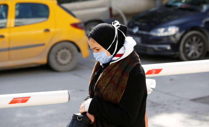 A woman wears a protective mask in Tunis, March 4, 2020.