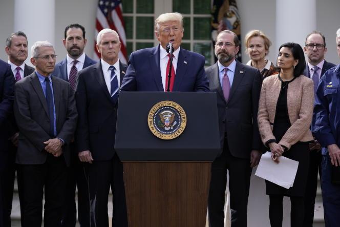 Le président américain Donald Trump lors d'une conférence de presse sur le coronavirus dans les jardins de la Maison Blanche, le vendredi 13 mars 2020, à Washington.