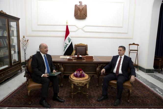 Le président irakien, Barham Saleh, et le nouveau premier ministre, Adnane Zorfi, à Bagdad, le 17 mars.