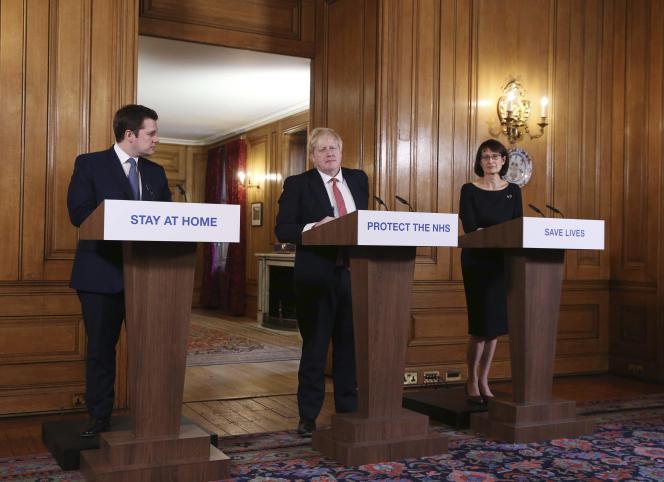 Boris Johnsonannonce des mesures pour limiter la propagation du Covid-19,lors d'un point de presse quotidien sur l'épidémie, le 22 mars.