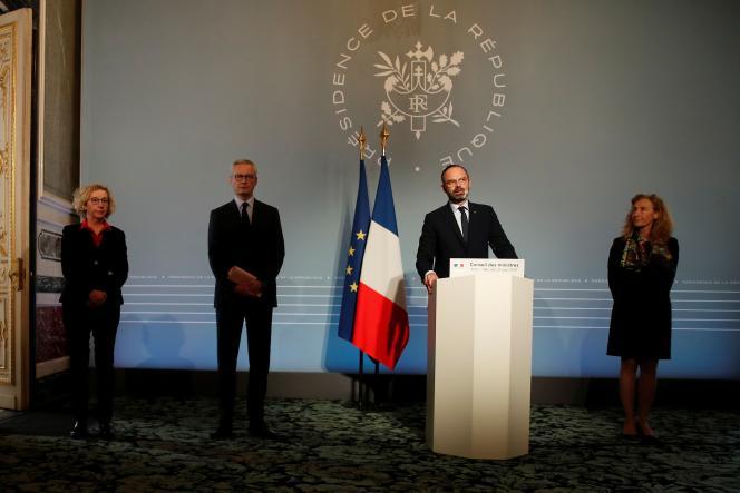 Les ministres du travail, Muriel Penicaud, de l'économie, Bruno Le Maire et le premier ministre Edouard Philipppe, à l'Elysée, le 25 mars.