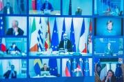 Capture d'écran de la vidéoconférence des membres du Conseil européen depuis le bureau de presse du Palazzo Chigi, à Rome, le 26 mars.