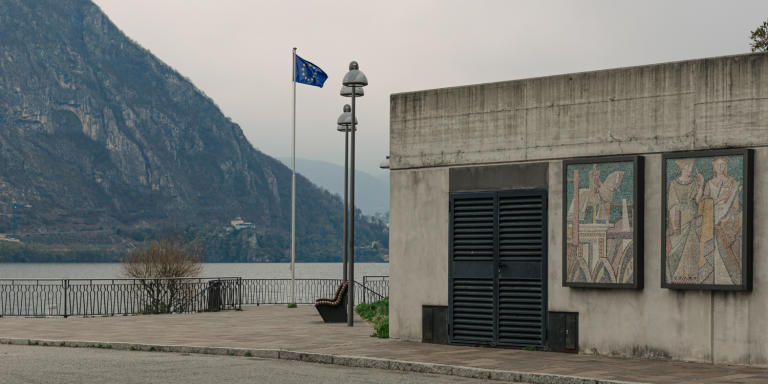 Campione d'Italia, 2020 – A European flag is placed on the lakeside. Against the wish of its residents, Campione formally became part of the EU customs territory on 1 January 2020.