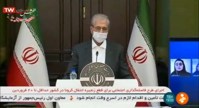 Capture d'écran de la chaîne Shabaké 2 : le porte-parole du gouvernementAli Rabiei porte un masque pour son point presse, diffusé au flash d'info de la télévision iranienne, le 30 mars.