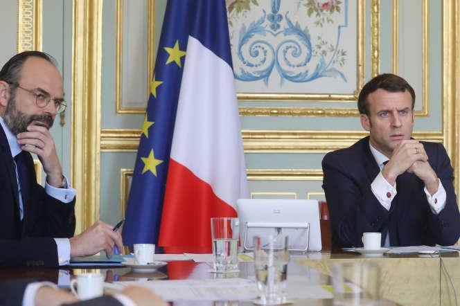 Edouard Philippe et Emmanuel Macron, à Paris, le 19 mars.