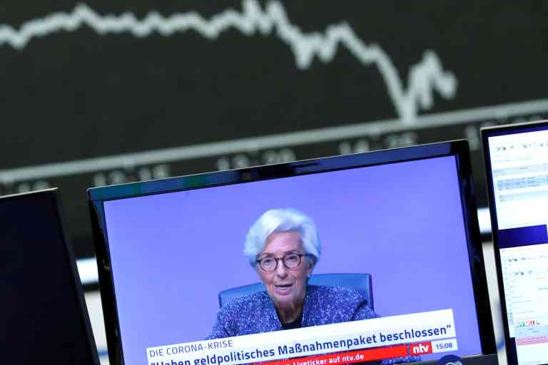 FILE PHOTO: A television broadcast showing Christine Lagarde, President of the European Central Bank (ECB), is pictured during a trading session at Frankfurt's stock exchange in Frankfurt, Germany, March 12, 2020.    REUTERS/Ralph Orlowski/File Photo