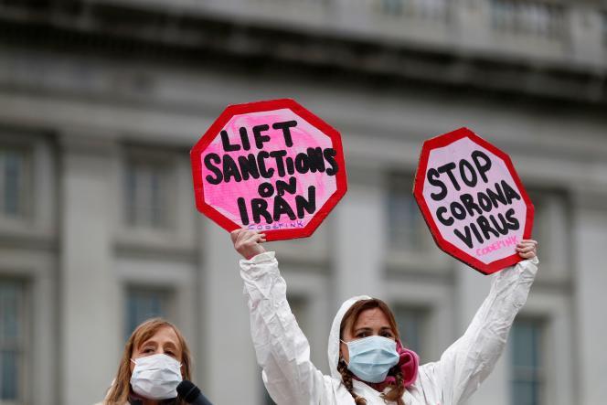 Des manifestants dénoncent les sanctions américaines contre l'Iran dans le contexte de padémie due au coronavirus, à Washington, le mars.