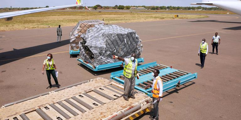 Airport staff unload cargo sent from Alibaba co-founder, Jack Ma, after it arrives at Juba International Airport in Juba, South Sudan on March 24, 2020. As the global pandemic takes root in Africa, Chinese billionaire Jack Ma announced he was donating 20,000 testing kits, 100,000 masks and 1,000 protective suits to each of the continent's 54 countries. / AFP / Alex McBride