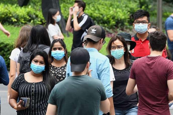 À Singapour dans un quartier de commerces, le 5 avril. Des mesures de confinement général sont de nouveau appliquées dans la cité-État de 6 millions d'habitants depuis le 7 avril, et jusqu'au 4 mai.