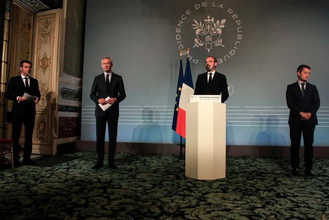 Olivier Véran, ministre de la santé, Bruno Le Maire, ministre de l'économie, le premier ministre, Edouard Philippe, et Gérald Darmanin, ministre de l'action et des comptes publics (de gauche à droite), le 15 avril, à Paris.