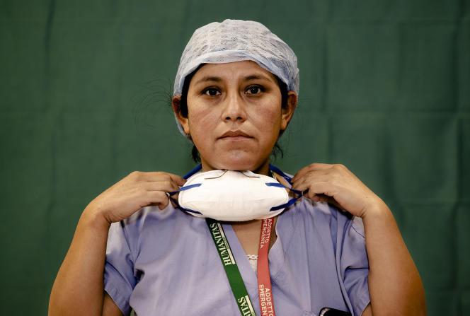 Une infirmière de l'hôpitalde Bergame (Italie) à la fin de son service. Le 27 mars.