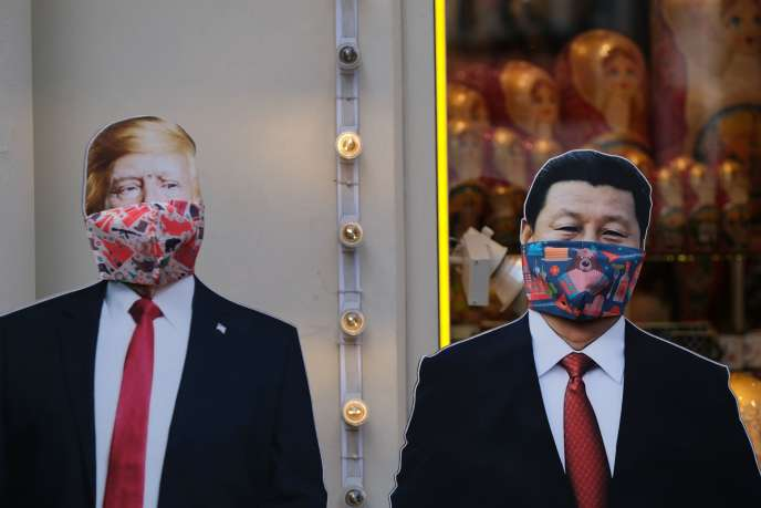 Cardboard cutouts of Donald Trump and Xi Jinping in a souvenir shop in Moscow on March 23.