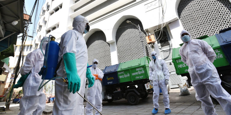 NEW DELHI, INDIA  APRIL 11: Dakshin Dilli Swachh Initiatives Limited (DDSIL) and SDMC public health department field workers arrive to chemically disinfect the area near Nizamuddin Markaz building, one of the twenty hotspot areas sealed to curb the spread of coronavirus, on the eighteen of the 21-day nationwide lockdown, on April 11, 2020 in New Delhi, India. (Photo by Ajay Aggarwal/Hindustan Times via Getty Images)