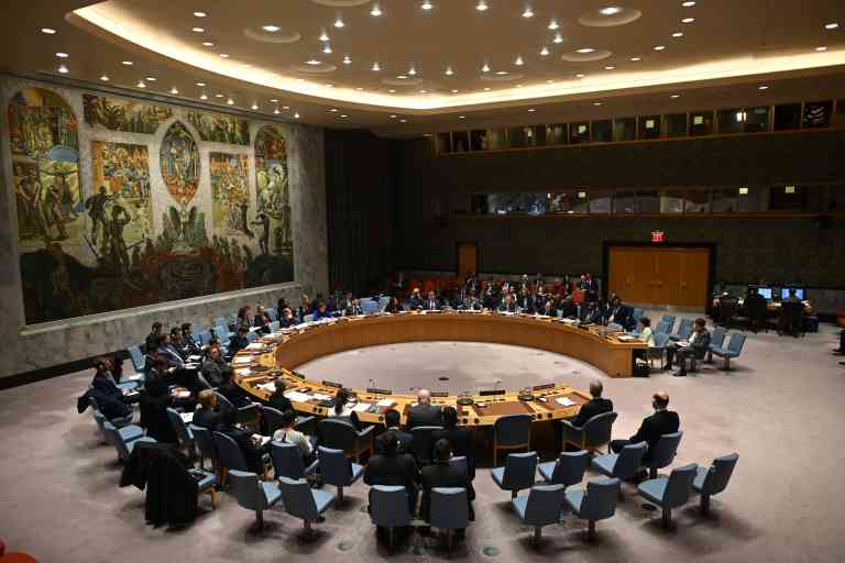 (FILES) In this file photo German Foreign Minister Heiko Maas (C) speaks at a UN Security Council meeting at United Nations headquarters in New York on February 26, 2020. After more than a month of controversy, a UN Security Council buffeted between the United States, China and Russia is finally expected this week of April 27, to adopt its first resolution on the coronavirus pandemic, amid calls for intensified international cooperation. / AFP / Johannes EISELE
