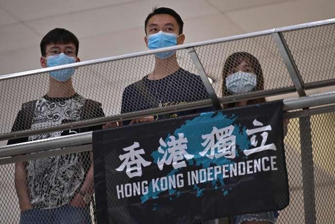 Des manifestants prodémocratie, le 1er mai, à Hongkong.