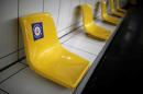 """A sticker reading """"For our common health, leave this seat empty"""" is pictured at Gare de Lyon metro station of Paris transport network (RATP) during the outbreak of the coronavirus disease (COVID-19) in Paris, France, May 2, 2020. REUTERS/Benoit Tessier"""