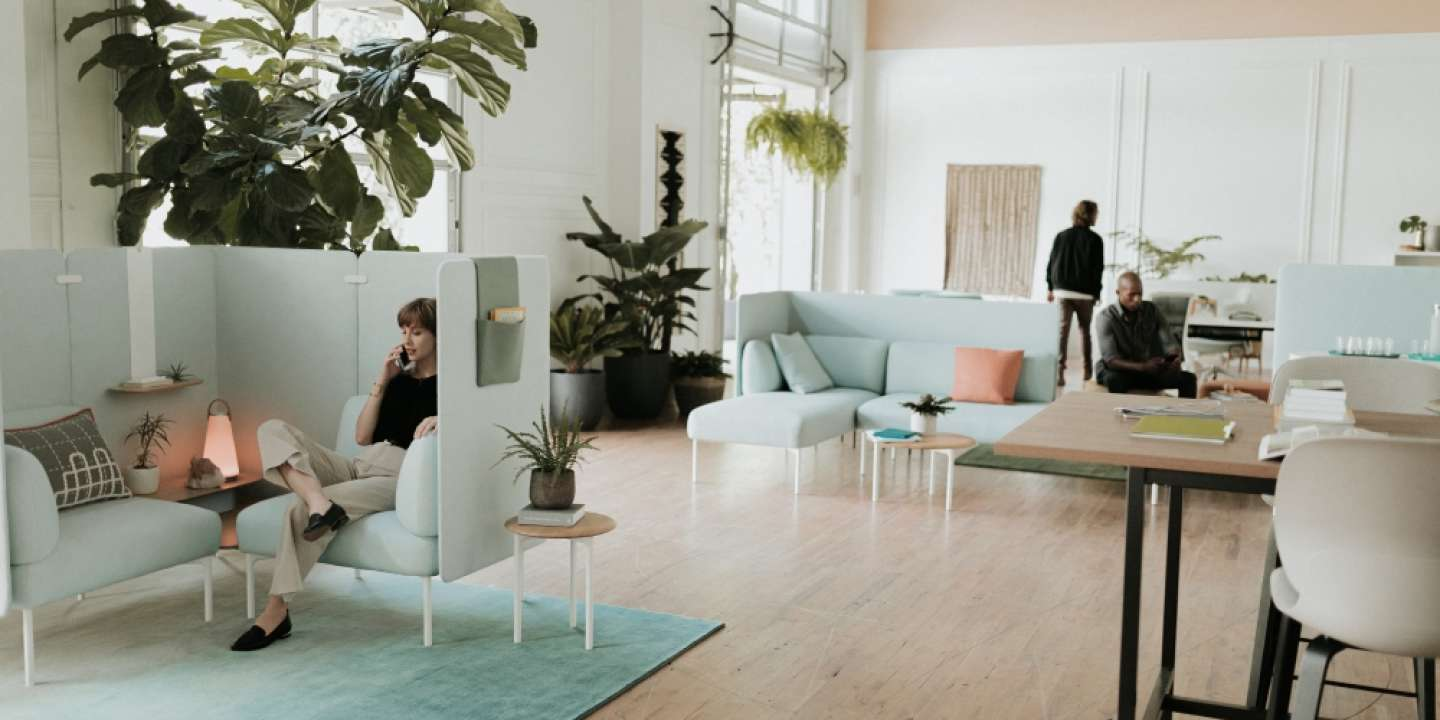 Two single seat sofas with two-tier table and high screens. Shown with UMA light, GAN rug and Openest Sprig tables. Also shown is a Cultivate table with Maari stools.