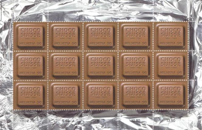 Timbre-poste aux effluves chocolatés, première mondiale réalisée en 2001 pour le centième anniversaire de Chocosuisse, l'union des fabricants suisses de chocolat.