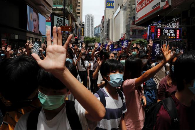 Lors de la manifestation dans le quartier de Causeway Bay à Hongkong, dimanche 24 mai.