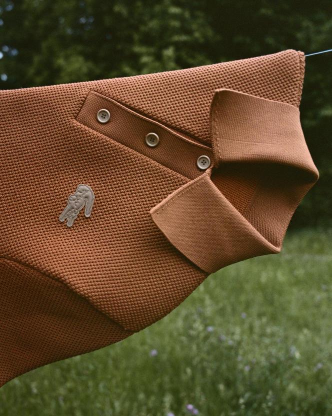 Polo en piqué de coton mélangé, effet gaufré, Lacoste, 390€.