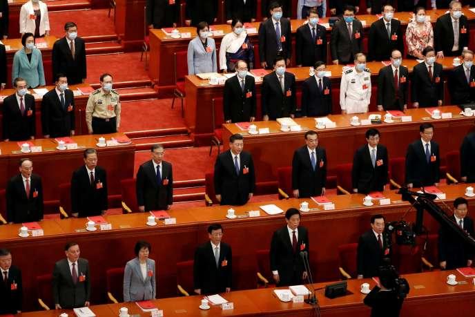 Le président chinois Xi Jinping et des responsables chinois assistent à la session de clôture de l'Assemblée populaire nationale (APN) au Grand Palais du Peuple à Pékin, le 28 mai.