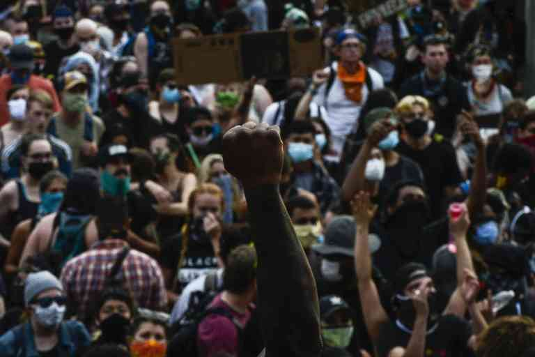 DENVER, CO - JUNE 01: People crowd in front of the Colorado State Capitol to protest on June 1, 2020 in Denver, Colorado. Protests continue in cities across the country after George Floyd, a black man, died in police custody in Minneapolis on May 25th.   Michael Ciaglo/Getty Images/AFP == FOR NEWSPAPERS, INTERNET, TELCOS & TELEVISION USE ONLY ==