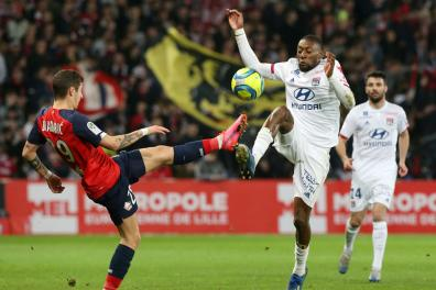 FILE PHOTO: Soccer Football - Ligue 1 - Lille v Olympique Lyonnais - Stade Pierre-Mauroy, Lille, France - March 8, 2020 Olympique Lyonnais' Karl Toko Ekambi in action with Lille's Domagoj Bradaric REUTERS/Francois Walschaerts/File Photo