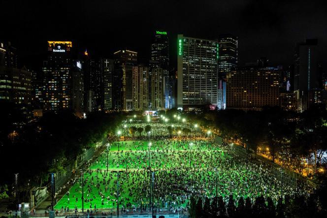 Rassemblement dans le parc Victoria pour marquer le 31eanniversaire de la répression de Tiananmen, à Hongkong, le 4 juin.
