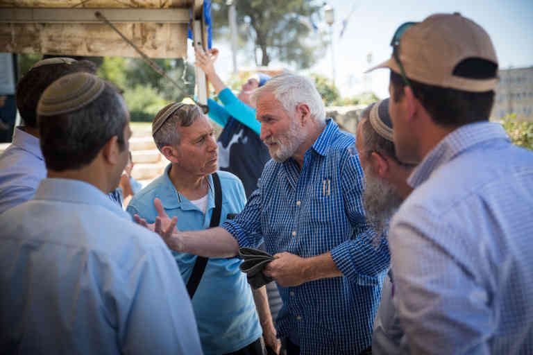 Ze'ev Chever (Zambish) speaks with heads of local authorities in Judea and Samaria at the protest tent of Beit el residents in front of the prime minister office in Jerusalem on June 18, 2017. The residents demand from prime minister Benjamin Netanyahu to build 300 apartments in Beit El as he promised five years ago. Photo by Yonatan Sindel/Flash90