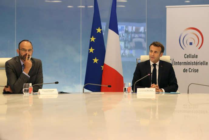 Le premier ministre Edouard Philippe et le président Emmanuel Macron, le 13 mai à Paris.