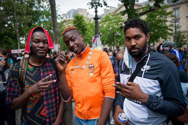 Mamadou Marega, Baba Daboet Job Dorvilma, lors de la manifestation contre le racisme, sur la place de la République, le 3 juin à Paris.