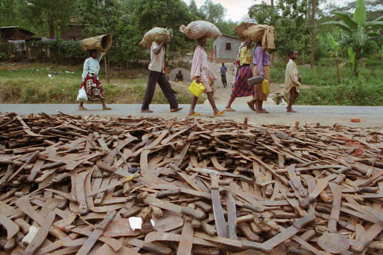 Thousands of abandoned machetes collect at the border of Rwanda and Tanzania, where Hutu refugees fleeing Rwanda are allowed across the border on the condition that they leave behind their weapons. | Location: border of Rwanda and Tanzania. (Photo by David Turnley/Corbis/VCG via Getty Images)