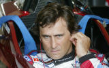 FILE PHOTO: Italian driver Alex Zanardi uses his ear sticks before sitting in the cockpit of his specially modified car at the Eurospeedway Lausitzring circuit in the eastern German town of Klettwitz May 11, 2003, before the German 500 CART race. Zanardi returned to the race track in Germany where he lost both legs in a crash. REUTERS/Fabrizio Bensch/File Photo