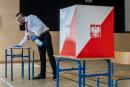 A member of a local electoral commission sprays disinfectant while cleaning table at a polling station during the presidential election in Warsaw on June 28, 2020. From a former trainee friar to a rabble-rousing eurosceptic to a gay rights trailblazer, the 11 candidates in Poland's presidential election on June 28, 202 are a varied bunch. President Andrzej Duda, who is backed by the right-wing government, faces his main challenge in the form of liberal opposition contender Rafal Trzaskowski. / AFP / Wojtek RADWANSKI