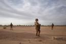 (FILES) In this file photo taken on November 09, 2019 Soldiers of the French Army monitor a deserted area during the Bourgou IV operation in northern Burkina Faso. French President Emmanuel Macron will travel on June 30, 2020 to Nouakchott in Mauritania to participate in a G5 Sahel summit to review the anti-Jihadist struggle in this region where more than 5,000 French soldiers are deployed. This meeting in the Mauritanian capital will be held 6 months after the summit in Pau (Southwest of France) where it was decided to intensify the anti-Jihadist struggle in a context of generalized deterioration of the security situation of particularly poor Sahelian countries. / AFP / MICHELE CATTANI