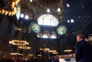 """This handout picture taken and released by the Turkish Presidential Press Service on March 31, 2018 shows Turkish President Recep Tayyip Erdogan speaking during the Arts Biennial opening, inside the Byzantine-era Hagia Sophia in Istanbul. (Photo by Handout / TURKISH PRESIDENTIAL PRESS SERVICE / AFP) / RESTRICTED TO EDITORIAL USE - MANDATORY CREDIT """"AFP PHOTO / TURKISH PRESIDENTIAL PRESS SERVICE/ Kayhan OZER"""" - NO MARKETING NO ADVERTISING CAMPAIGNS - DISTRIBUTED AS A SERVICE TO CLIENTS"""