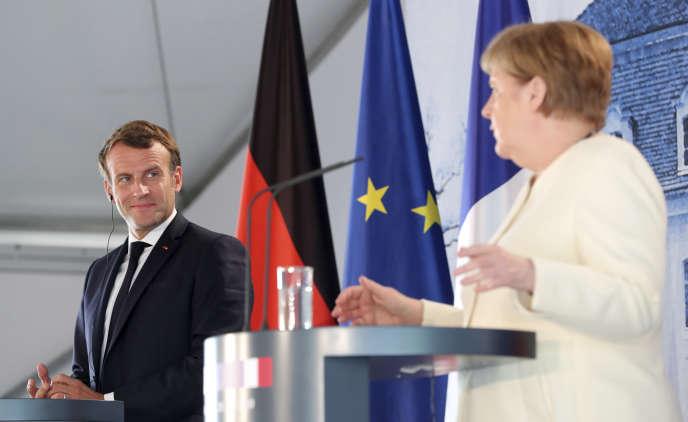 La chancelière allemande Angela Merkel et le président français Emmanuel Macron lors d'une conférence de presse conjointe au château de Meseberg, près de Berlin, le 29 juin.