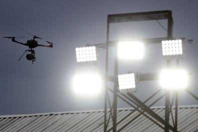 A television camera drone flies over the pitch ahead of the English Premier League football match between Crystal Palace and Burnley at Selhurst Park in south London on June 29, 2020. RESTRICTED TO EDITORIAL USE. No use with unauthorized audio, video, data, fixture lists, club/league logos or 'live' services. Online in-match use limited to 120 images. An additional 40 images may be used in extra time. No video emulation. Social media in-match use limited to 120 images. An additional 40 images may be used in extra time. No use in betting publications, games or single club/league/player publications. / AFP / POOL / Catherine Ivill / RESTRICTED TO EDITORIAL USE. No use with unauthorized audio, video, data, fixture lists, club/league logos or 'live' services. Online in-match use limited to 120 images. An additional 40 images may be used in extra time. No video emulation. Social media in-match use limited to 120 images. An additional 40 images may be used in extra time. No use in betting publications, games or single club/league/player publications.