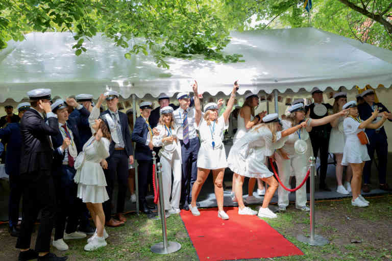 Graduating students sing and dance inside and out of the makeshift lunch tents that have been put up on the school premises for the students to have lunch separately due to the Covid 19 pandemic at ProCivitas gymnasium in Lund.