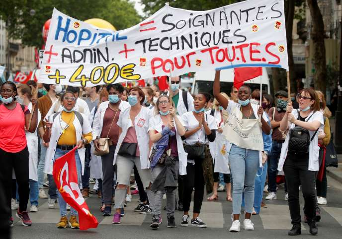 Hospital workers take part in a demonstration in Paris to ask the government to improve wages and invest in public hospitals on June 30, 2020.