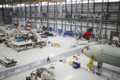 Airbus SE A321 plane fuselages sit on the production floor at the company's final assembly line facility in Mobile, Alabama, U.S., on Wednesday, July 19, 2017. The U.S. Census Bureau is scheduled to release durable goods figures on August 3. Photographer: Luke Sharrett/Bloomberg via Getty Images