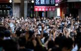 TOPSHOT - Protesters chant slogans and gesture during a rally against a new national security law in Hong Kong on July 1, 2020, on the 23rd anniversary of the city's handover from Britain to China. Hong Kong police arrested more than 300 people on July 1 -- including nine under China's new national security law -- as thousands defied a ban on protests on the anniversary of the city's handover to China. / AFP / Anthony WALLACE