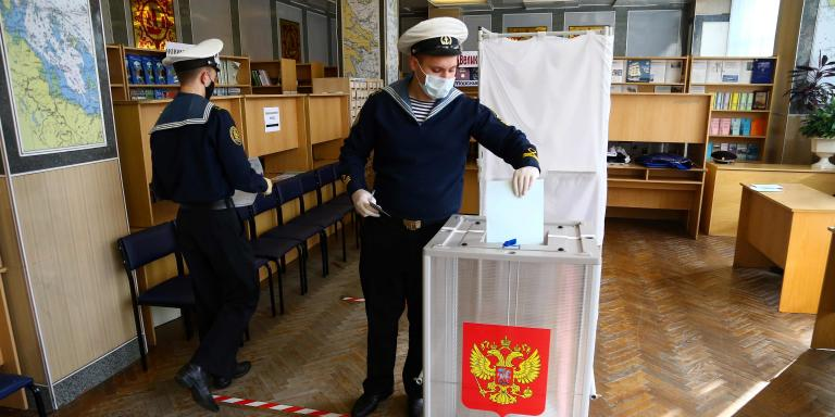 A naval cadet casts his ballot in a nationwide vote on constitutional reforms at a polling station in the far eastern city of Vladivostok on July 1, 2020. / AFP / Pavel KOROLYOV