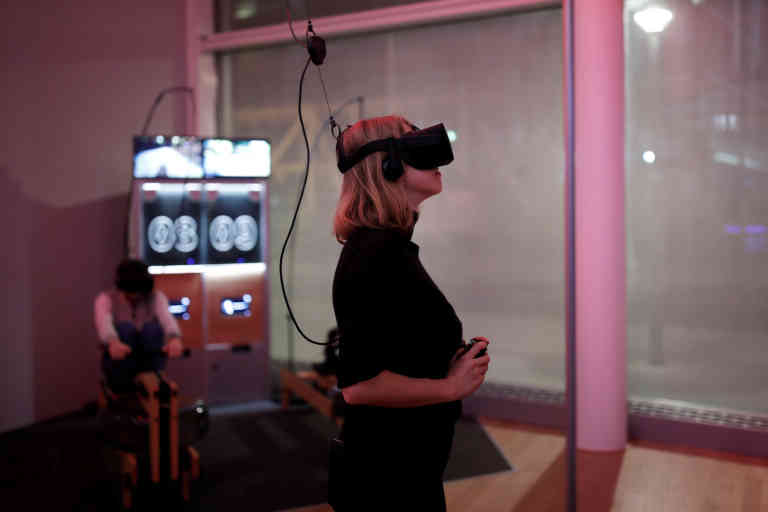 A woman plays a video game with the Oculus Rift VR headset at the mk2 VR, a place dedicated to virtual reality in Paris, France, December 5, 2016. REUTERS/Benoit Tessier - RC170F1B0F20