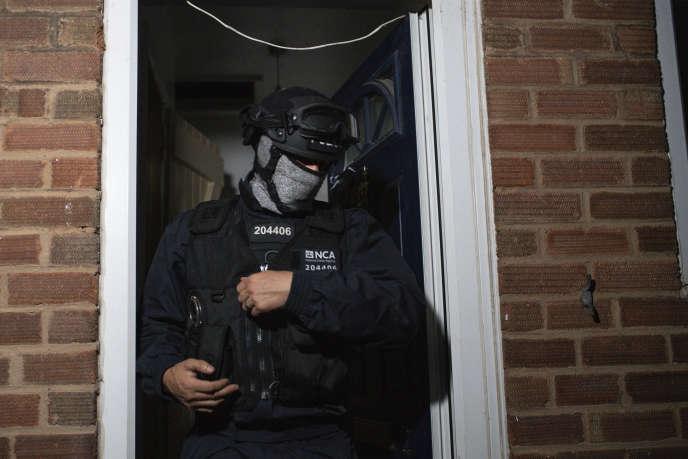 Opération de la police britannique à Birmingham, le 26 juin 2020, à partir d'informations glanées sur EncroChat.