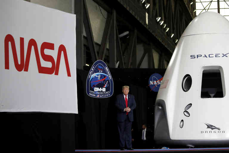President Donald Trump stands on stage during an event at the Vehicle Assembly Building on Saturday, May 23, 2020, after viewing the SpaceX flight at NASA's Kennedy Space Center in Cape Canaveral, Fla. A rocket ship designed and built by SpaceX lifted off on Saturday with two Americans on a history-making flight to the International Space Station. (AP Photo/Alex Brandon)