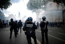 Police officers and National Gendarmerie members stand guard during a protest against police brutality and the death in Minneapolis police custody of George Floyd, in Paris, France June 13, 2020. REUTERS/Benoit Tessier